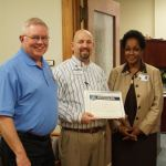 City Manager John Whitson and City Secretary Jennifer Evans with Super 1 Foods General Manager Frankie Conway